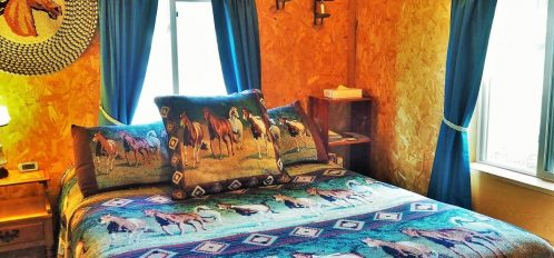 An extremely comfortable bed in The Outlaw cabin.