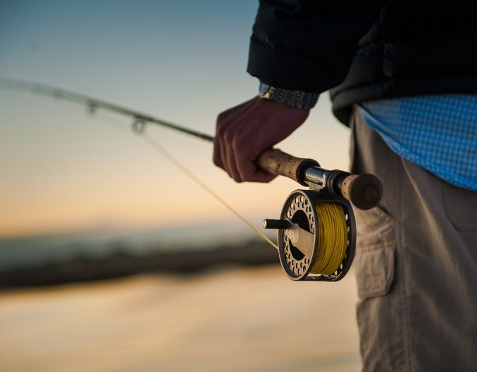 Man with a fishing rod enjoying Gila National Forest fishing